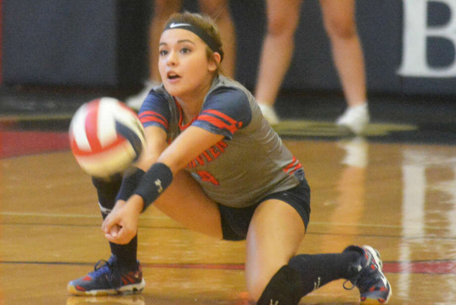 Plainview libero Mariah Hernandez goes to a knee to return a serve during the Lady Bulldogs' victory over Dimmitt Tuesday. Hernandez, a senior, is leading the team in digs as Plainview prepares to start District 4-5A play Friday. Photo: Skip Leon/Plainview Herald