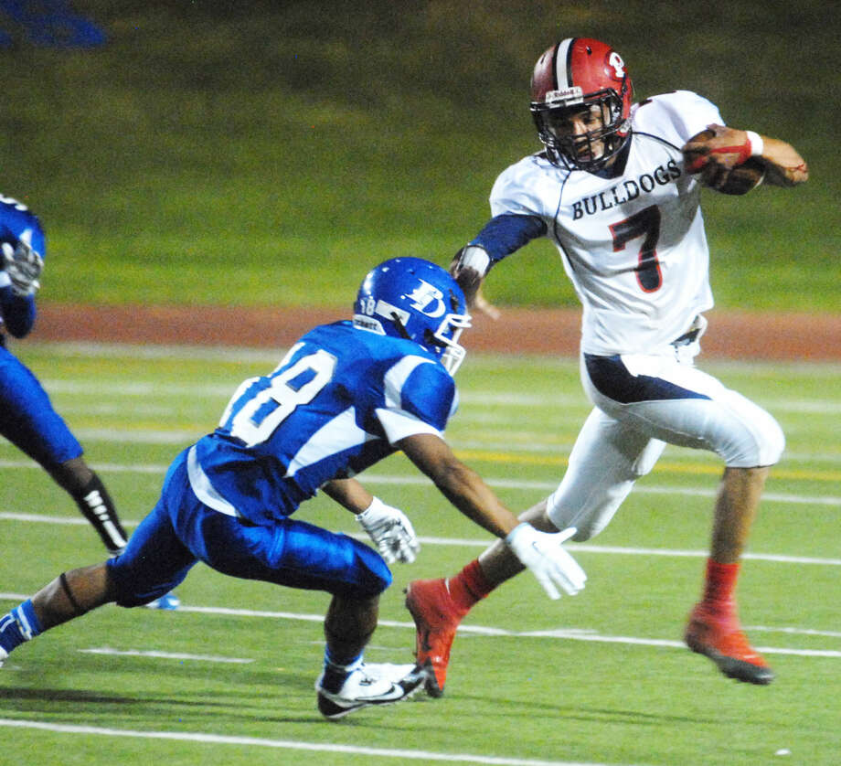 Plainview safety Keevon Crump (7) tries to avoid Palo Duro's Anthony McClain after intercepting a pass against the Dons Thursday night. McClain scored on a 50-yard rn late in the game to secure a 34-26 victory for PD. Photo: Homer Marquez/Plainview Herald