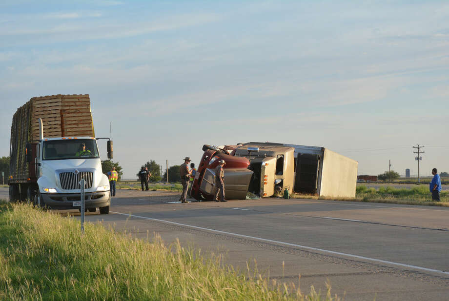 Doug McDonough/Plainview HeraldAn 18-wheel truck-trailer combination overturned shortly before 8 a.m. Friday, Sept. 5, as it was negotiating a slight curve in Interstate 27 about one mile south of the FM 788 overpass at Finney. The truck was traveling south on the highway when the mishap occurred. There were no apparent injuries, although traffic was disrupted until the truck could be pulled upright and removed.