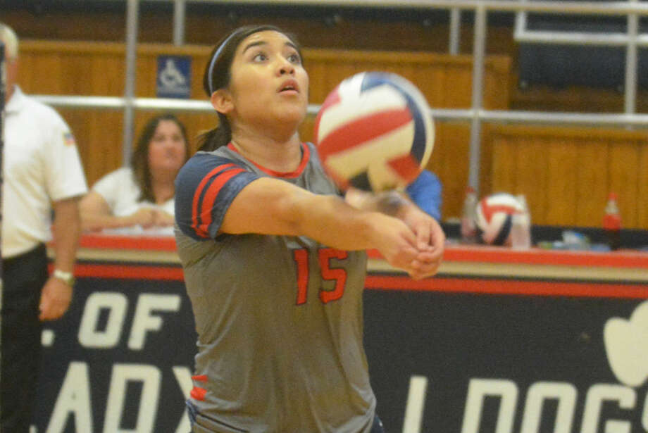 Plainview setter Lori Gonzalez gets the ball into the air to one of her hitters during a District 4-5A volleyball match against Abilene Cooper at the PHS gym Tuesday. Cooper handed the Lady Bulldogs their first defeat in district play. Both teams are 1-1. Photo: Skip Leon/Plainview Herald
