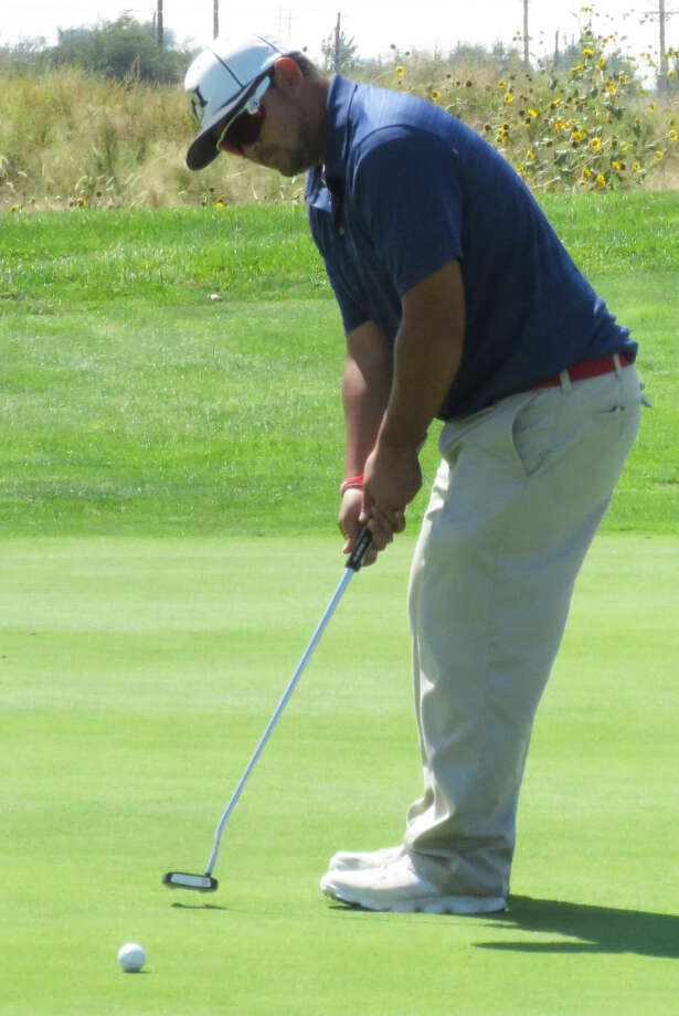 Plainview's Troy Velasquez putts the ball during the Amarillo Triangular at Comanche Golf Course Saturday. Velasquez was one of three Bulldogs to shoot a 74 as they finished with a 294 team score, which was the low score of all teams for the day. Photo: Photo Courtesy Of Betsy Lewis