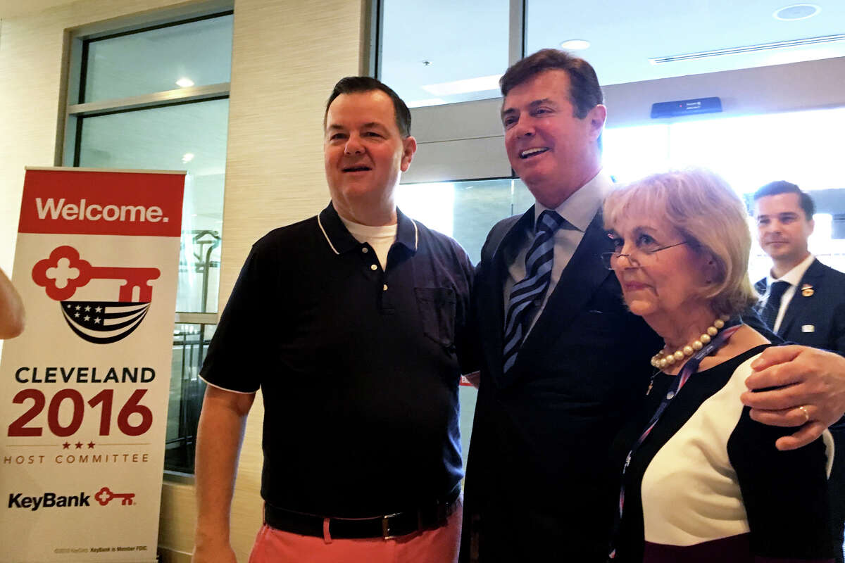Trump campaign manager Paul Manafort, center, poses for a photograph with state Rep John Frey of Ridgefield and Pat Longo of Norwalk during a Connecticut GOP breakfast Tuesday, July 19, 2016, in Cleveland. Frey and Longo both serve on the Republican National Committee.