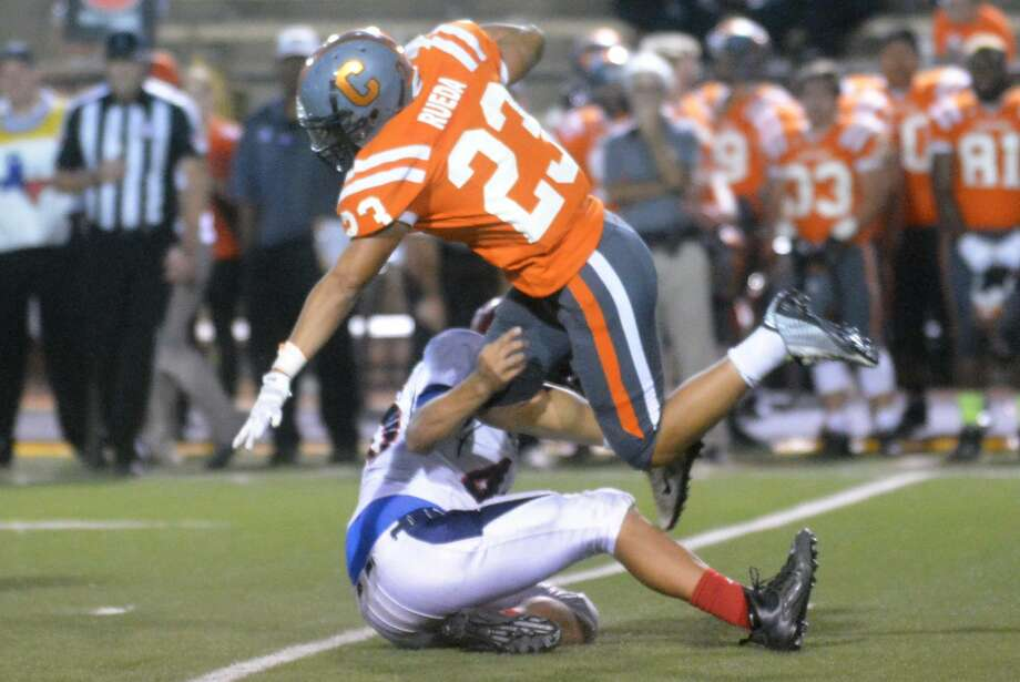 Plainview defensive end J'ryn Vela gets low to trip up a Caprock runner during a game earlier this season. The Bulldogs had four takeaways against Dumas last week and will look to continue their strong defensive play at Hereford Friday night. Photo: Skip Leon/Plainview Herald