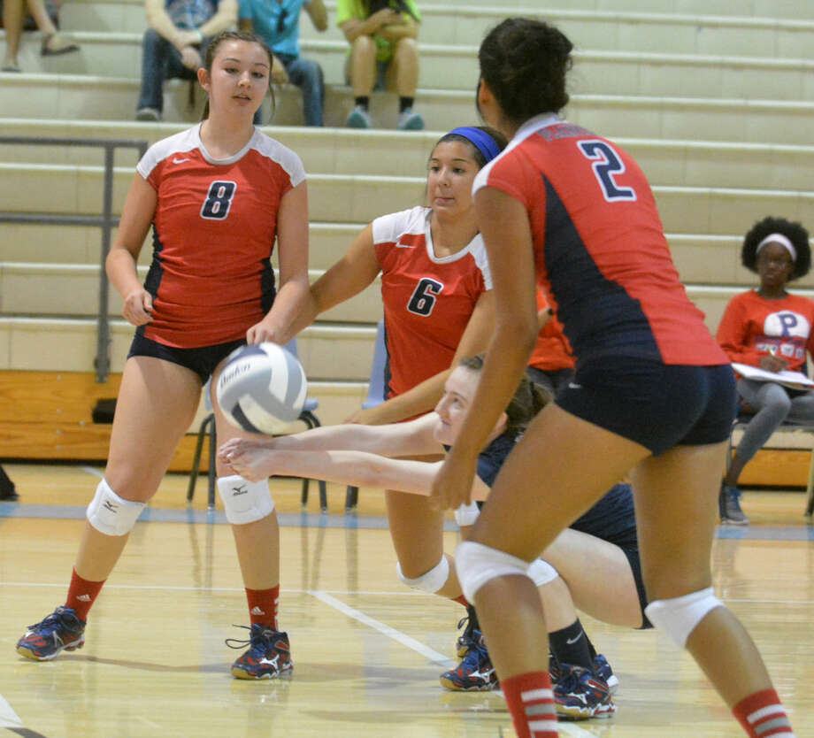 Plainview libero Meredith McDonough gets low to return a serve during a match against Lubbock Monterey earlier this season. Looking on are teammates Taryn Garza (8), Caitlyn Isaguirre (6) and Alondra Fraire (2). The Lady Bulldogs won one of six matches at the Frenship Tournament Friday and Saturday. One of their losses in bracket play Saturday was to Monterey. Plainview will return to the court this Saturday when they host Frenship at noon. Photo: Skip Leon/Plainview Herald