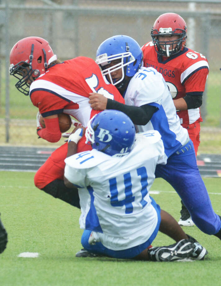A Plainview junior varsity running back carries two Palo Duro tacklers as he gains yardage in a game at Greg Sherwood Memorial Bulldog Stadium Friday afternoon. Photo: Skip Leon/Plainview Herald