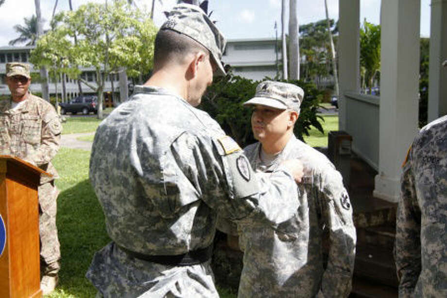 Sgt. Jon Heinrich, 8th TSC Public Affairs Photo Sgt. Nathan Levi Ramos of Plainview, a paralegal noncommissioned officer with 8th Theater Sustainment Command, receives an Army Commendation Medal from Maj. Gen Todd B. McCaffrey, deputy commanding general for U.S. Army Pacific, on Sept. 25 at Fort Shafter, Hawaii, after placing first in the USARPAC 2015 Paralegal Warrior Challenge in the NCO of the Year Category.