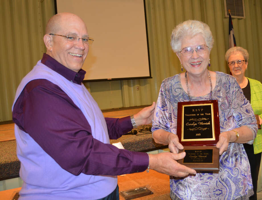 Doug McDonough/Plainview Herald Runningwater Draw RSVP Chairman Gary Stennett presents the Volunteer of the Year plaque to Carolyn Warrick of Plainview during the group's 42th annual volunteer recognition banquet on Tuesday.