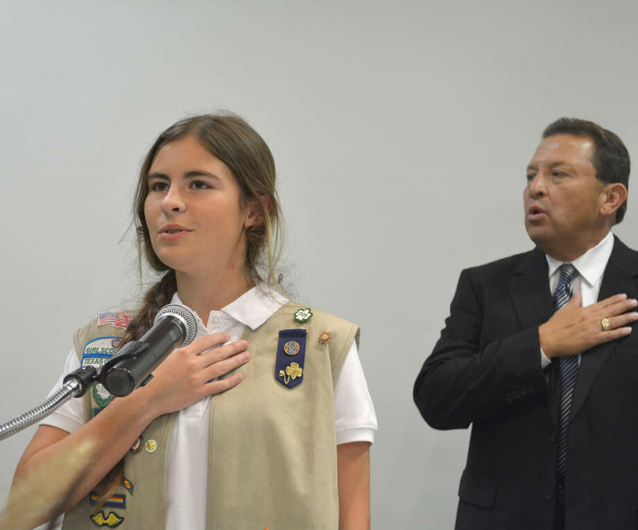 Doug McDonough/Plainview HeraldGirl Scout AnnMarie Rushing leads the Pledge of Allegiance to open the 2014 Plainview Area United Way Kickoff Luncheon on Monday following the presentation of colors by local Boy Scouts. At right is V.O. Ortega, United Way president.