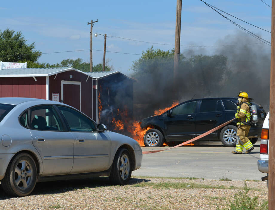 Doug McDonough/Plainview HeraldAn auto fire reported at 2 p.m. Tuesday damaged an unattended Ford Edge and two storage buildings outside the South Plains Community Action Association/Texas Migrant Council Head Start complex at 1110 El Camino St. Once Plainview Fire Department units arrived, the fire was quickly extinguished. As a precaution, children at the facility were moved to the Primera Iglesia Bautista at 1205 Avenida Godsey.