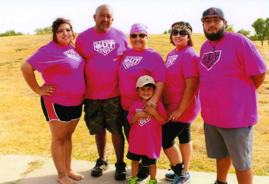 In support of battle against breast cancer, Virginia Leal's family held a special softball benefit tournament this past September. From left are Victoria Leal, Robert Leal, Virginia, Maddox Salazar, Vanessa Salazar and Zachary Leal.