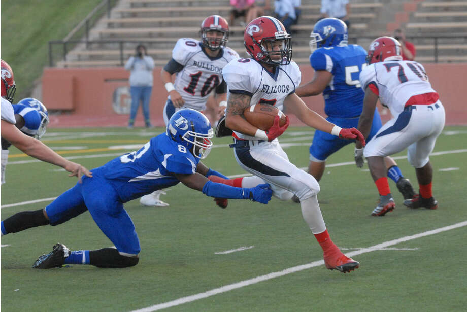 Plainview running back Warren Flye races past a Palo Duro defender during last week's football game. Flye, a senior, gained 158 yards rushing against the Dons and has 214 yards on the ground in two games. The Bulldogs make their home debut this week when the host Canon at 7:30 p.m. Friday. Photo: Homer Marquez/Plainview Herald