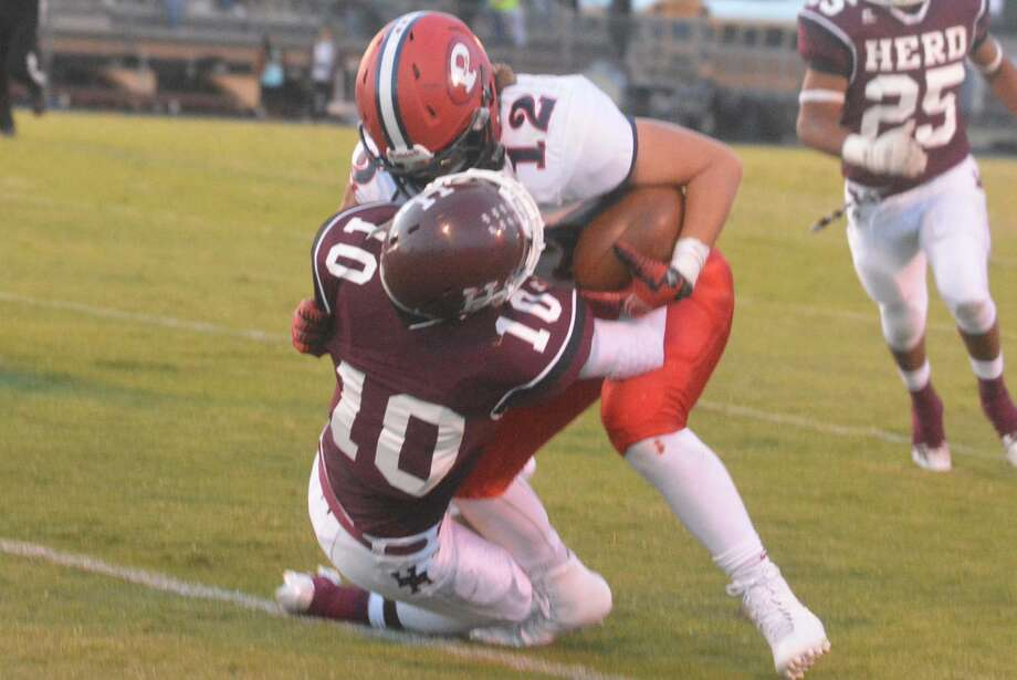 Plainview running back Wrangler Haresnape (12) tries to bowl over a Hereford defender during last week's final non-district football game. The Bulldogs, who sport a 3-3 record, are off this week before they begin District 4-5A play at Abilene Cooper Oct. 16. Photo: Skip Leon/Plainview Herald