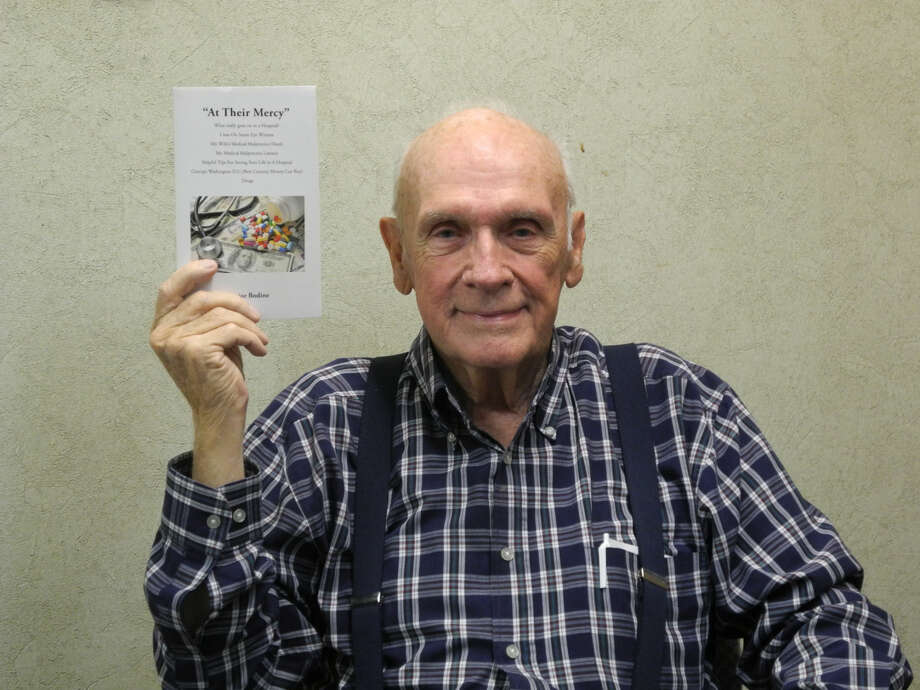 """Vance Scoggin, 81, displays his recently published book """"At Their Mercy."""" In it, he details his wife's death and his subsequent malpractice suit. He hopes others can learn from his experience. Photo: Gail M. Williams 