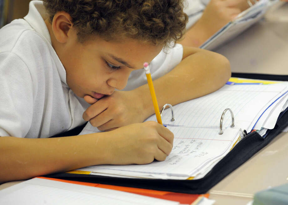 Fifth-grade student Darius Riley writes cursive during one of the class lessons at Highlandtown Elementary School in Baltimore, Md., Nov. 23, 2011. (Lloyd Fox/Baltimore Sun/MCT) Photo: Lloyd Fox
