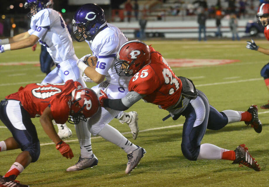 Plainview's Damian Guerrero (35) and Zane Ponder (left) team up to tackle Canyon's Cole Mason during a football game at Greg Sherwood Memorial Bulldog Stadium Friday night. Photo: Skip Leon/Plainview Herald
