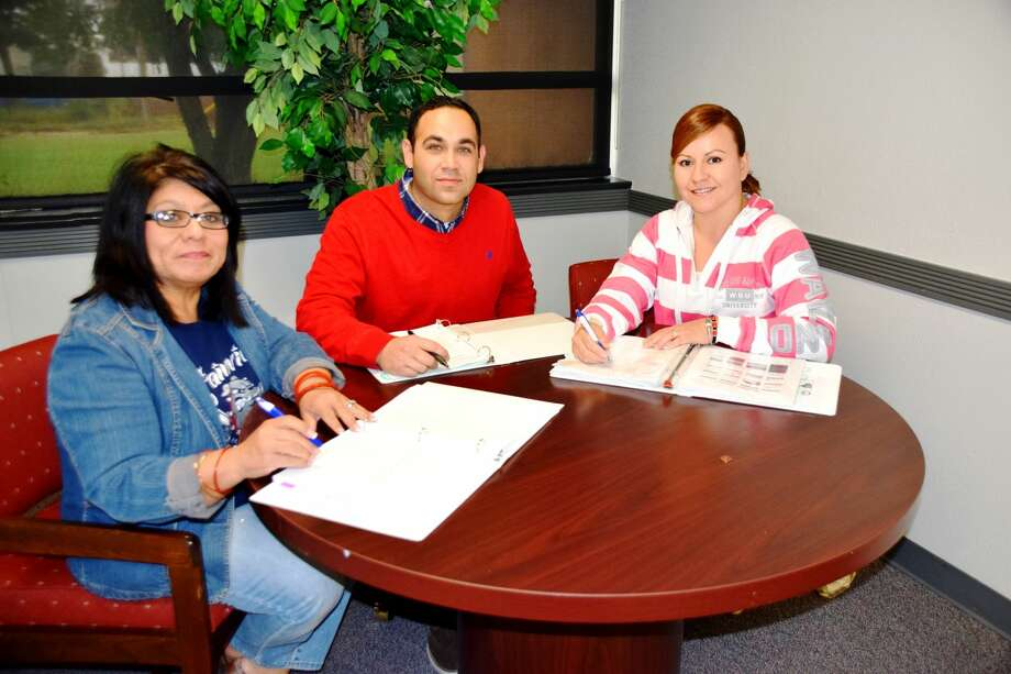 Plainview ISD migrant department personnel Linda Quezada, Humberto Gonzalez, and Brenda Valdez.