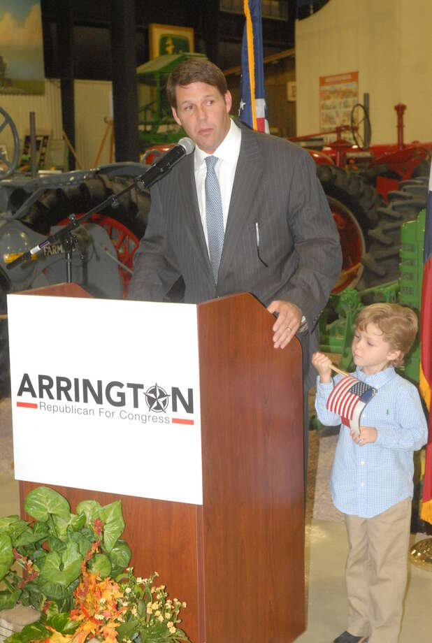 U.S. Congress candidate Jodey Arrington announces his plans to run for office Thursday as son, Nathen, stands next to him. Photo: Homer Marquez/Plainview Herald
