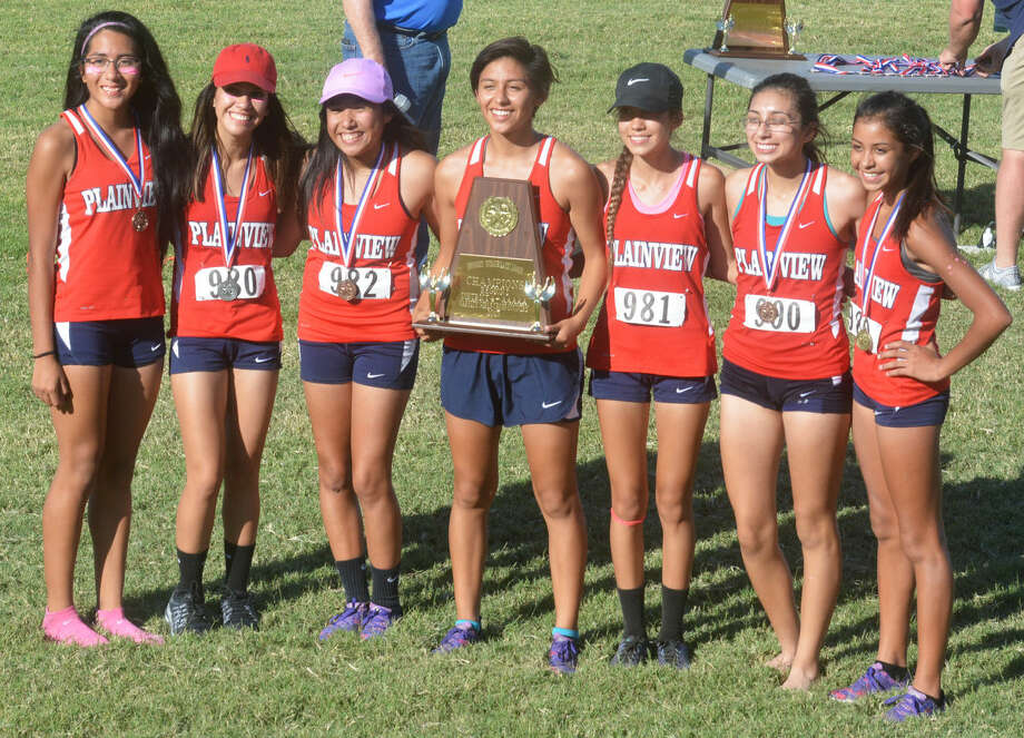 The Plainview girls cross country team won their second consecutive District 4-5 championship at Mae Simmons Park in Lubbock Thursday. Members of the team are, from left, Alexis Banda, Breana Figueroa, Klarysa Godino, Cassandra Delgado (holding trophy), Elisabeth Garcia, Abby Soto and Kristan Rincon. Photo: Skip Leon/Plainview Herald