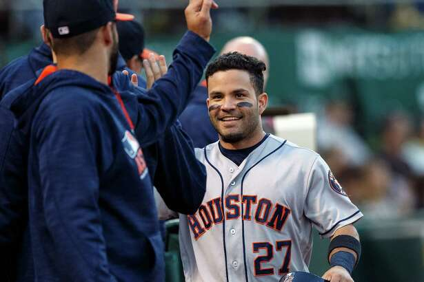 OAKLAND, CA - JULY 19:  Jose Altuve #27 of the Houston Astros is congratulated by teammates after scoring a run against the Oakland Athletics during the third inning at the Oakland Coliseum on July 19, 2016 in Oakland, California.
