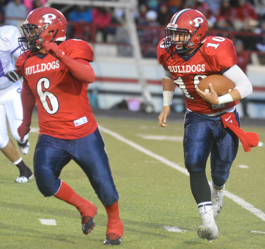Plainview quarterback Paxstyn Oldfield (10) runs for yardage behind the blocking of Domingo Saucedo (6) during last week's football game against Canyon. The Bulldogs are hoping to earn their first win of the season when they host Caprock on Homecoming night Friday at 7:30 p.m. Photo: Skip Leon/Plainview Herald
