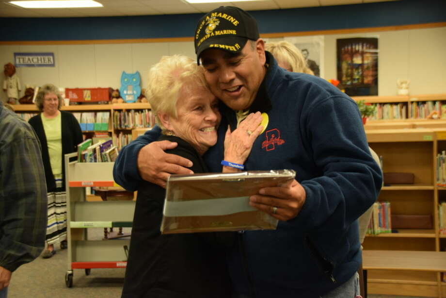 Jan Seago/Plainview ISDRetired teacher Ann Hamilton Perry hugs her former student, Adam Soto, during Thunderbird's 50th Anniversary Celebration on Thursday. Soto, current school board president, spoke of the impact Perry had on his life as his most influential teacher during his address to the school district staff in August.