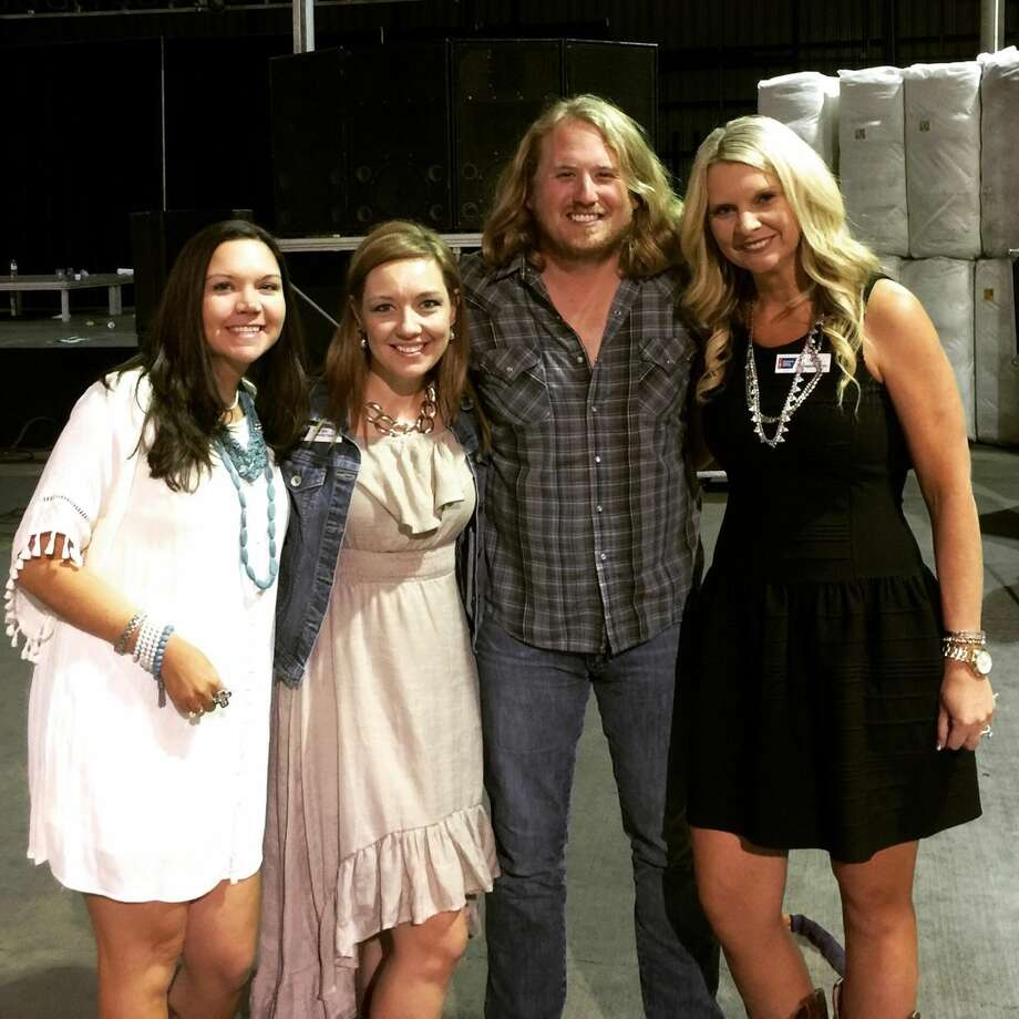 Featured entertainment at the 2015 Cotton Baron's Ball Saturday was country singer William Clark Green. Also photographed with him is event co-chair Heather Riley, Senior Market Manger of the American Cancer Society Kathy Oaks and Senior Manager of Distinguished Events Misti Welch.
