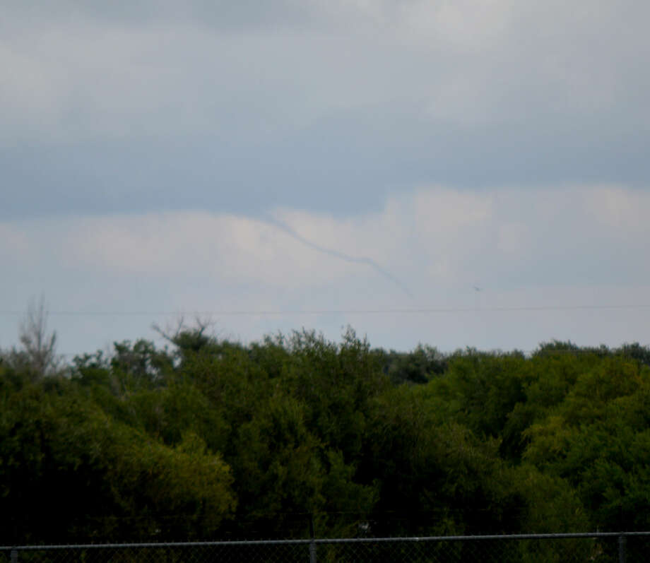A slender rope-like funnel cloud east of Plainview is seen shortly after 5 p.m. Saturday from the Plainview Cemetery. It was likely hanging over eastern Hale County or western Floyd County. There were no reports that the funnel cloud actually touched down to form a tornado, and there were no damage reports.