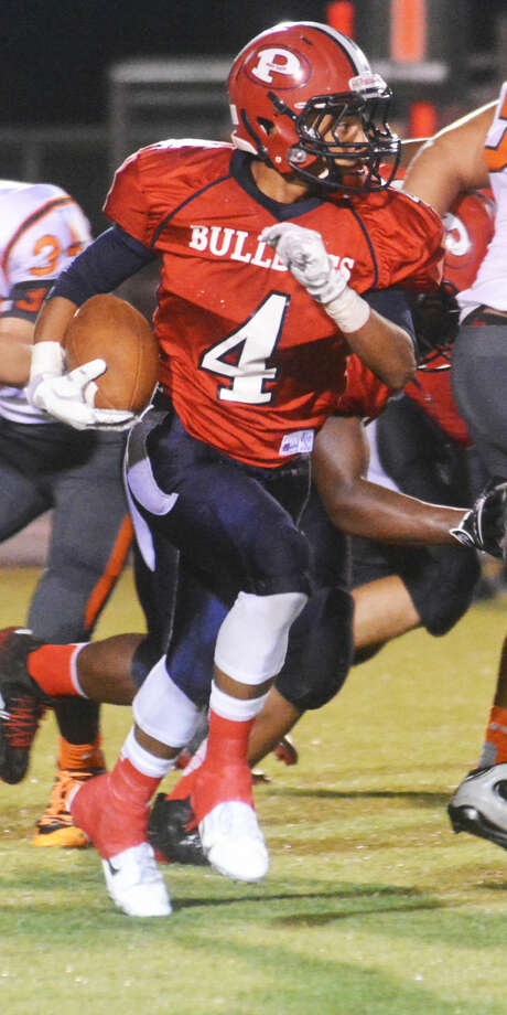 Plainview running back Trendan Jackson gains yardage against Caprock Friday night. The sophomore ranks fourth in District 4-5A rushing and has helped the Bulldogs accumulate more offensive yards than any district team in the first four games of the season. Photo: Skip Leon/Plainview Herald