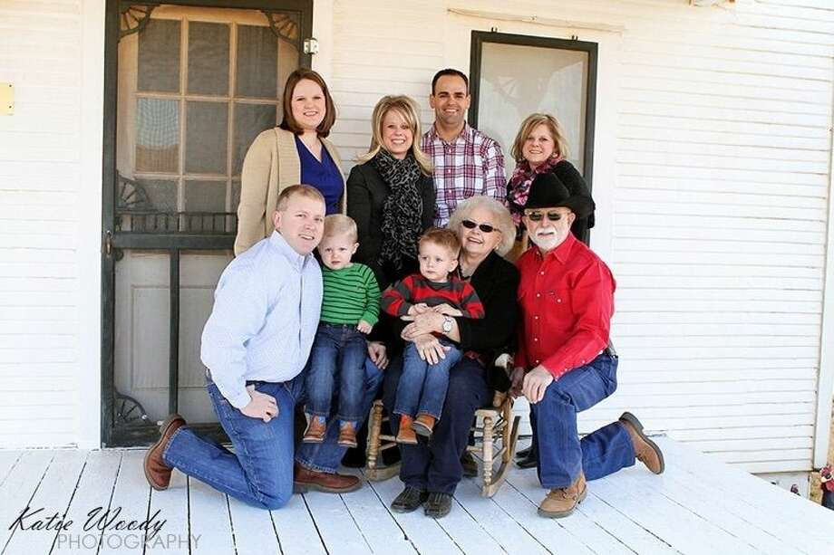 Kneeled to the right of his family is farmer and Hale Center Fire Chief Ronald Groves with wife Beverly, grandson Landry, daughter Wendi, son-in-law Cody Swift, daughter Misti, daughter-in-law Chelsi and son Gregg with grandson Corbin. Photo: Homer Marquez/Plainview Herald