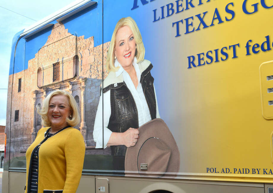 Libertarian candidate Kathie Glass, the Libertarian nominee for Texas governor, stands beside her tour bus during a campaign stop in Plainview on Monday. She is in the process of touring all 254 Texas counties.