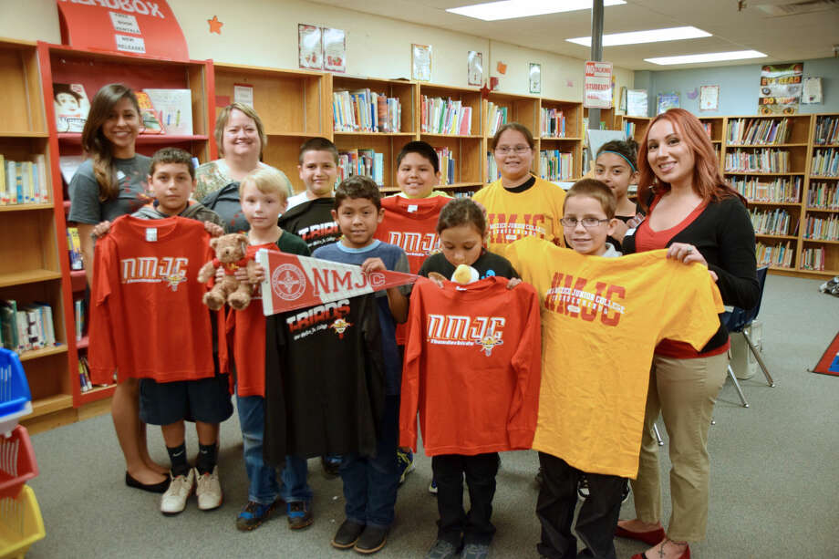 Highland gets college gearJan Seago/Plainview ISDNew Mexico Junior College representatives Diana Juarez (left) and Natalie De Jesus (right) made a stop at Highland Elementary on Tuesday to bring NMJC T-shirts, stuffed mascots and a banner to share with students. The representatives were invited to visit the campus by teacher Sharon Lambeth (back, second from left) as part of the campus' effort to build college and career readiness. Lambeth is an alumni of NMJC. Students displaying the NMJC items are Joshua Barretero (front left), Andrew Myrick, Anthony Lucio, Justice Rodriguez, Smiley Estrada, Andrew Camacho (back left), Sebastian Mendoza, Cloe DeLeon and Zaima Davila.