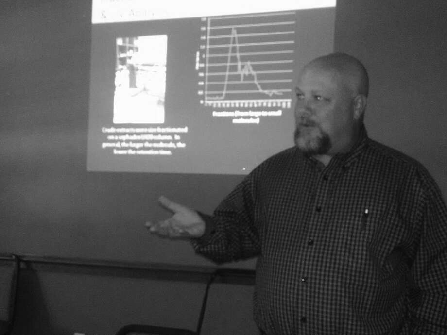 Jonathan Petty/Wayland Baptist University Wayland Baptist University professor Dr. Adam Reinhart gives details of his team's research on the effect of medicinal plants on breast cancer cells to the Plainview Kiwanis Club on Thursday.