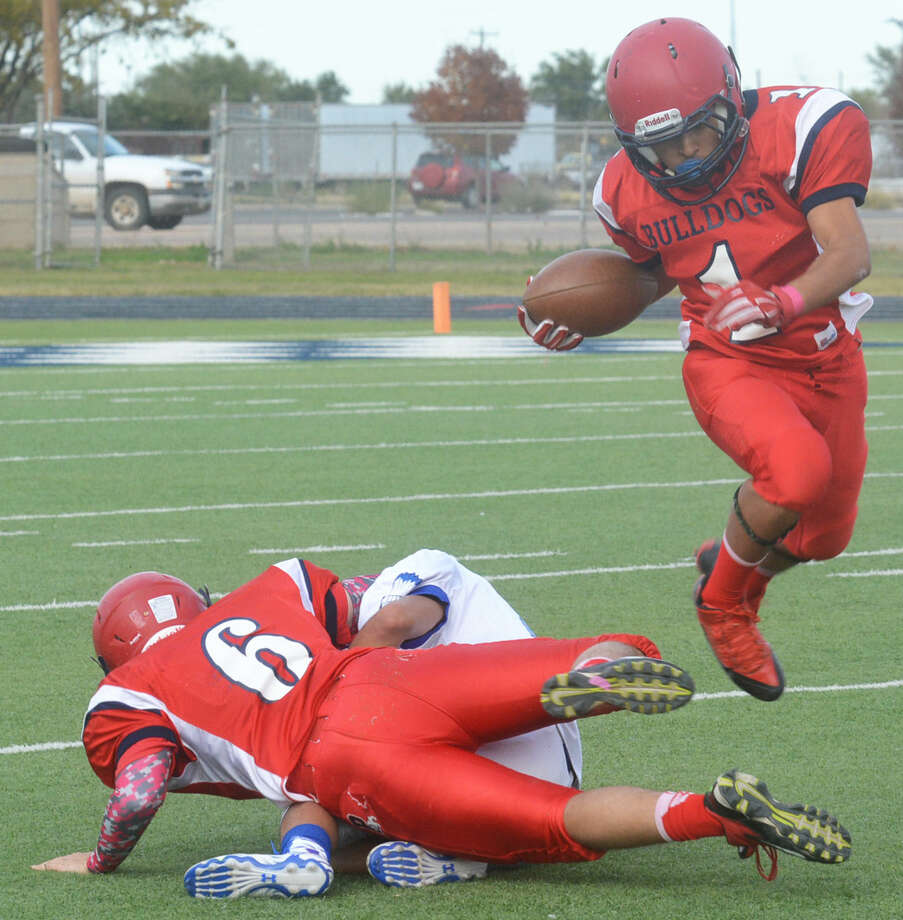 Plainview running back Jerrico Enriquez leaps over teammate Kit Kingston (6), who makes a block to spring him for yardage during a junior varsity football game Thursday. Enriquez and Kingston scored touchdowns, but the jayvees lost to San Angelo Lake View 16-12. Photo: Skip Leon/Plainview Herald