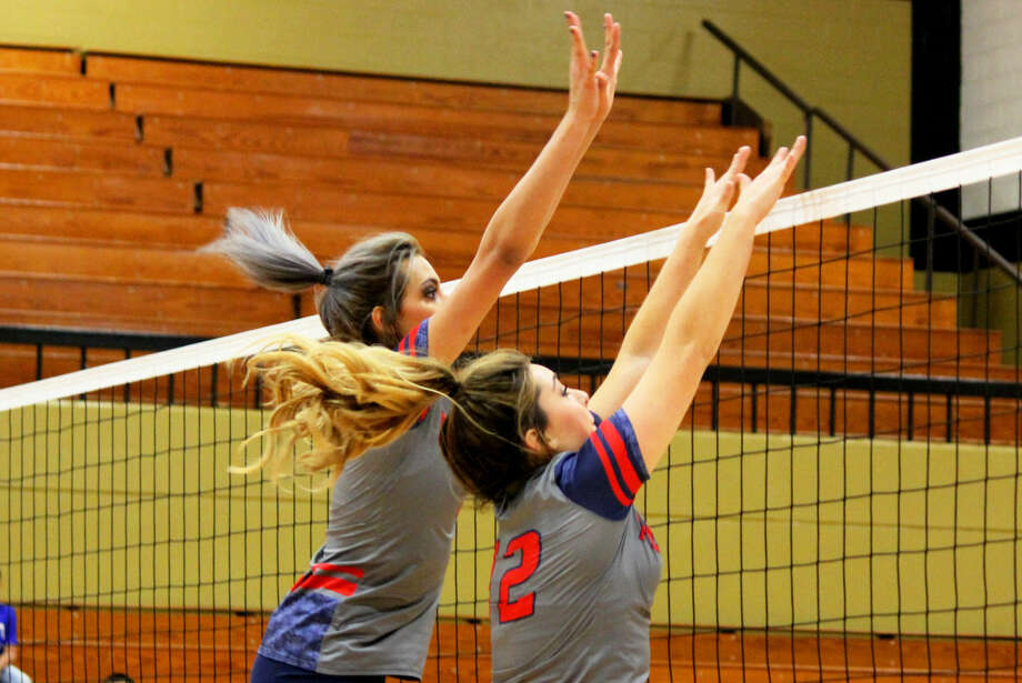 Plainview's Harlee Davis (left) and Shadee Tye (right) attempt to block a shot by San Angelo Lake View during a play-in match Friday. The Lady Bulldogs won and will host Randall in a bi-district round playoff Tuesday. Photo: Photo Courtesy Of Curtis Bailey