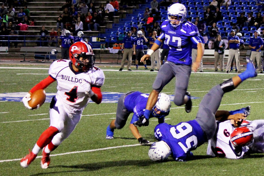 Plainview running back Trendan Jackson turns the corner and gains yardage as San Angelo Lake View players are scattered on the field during Friday's game in San Angelo. Bulldog quarterback Marc Ramos (9) throws a block to spring Jackson. Photo: Photo Courtesy Of Curtis Bailey