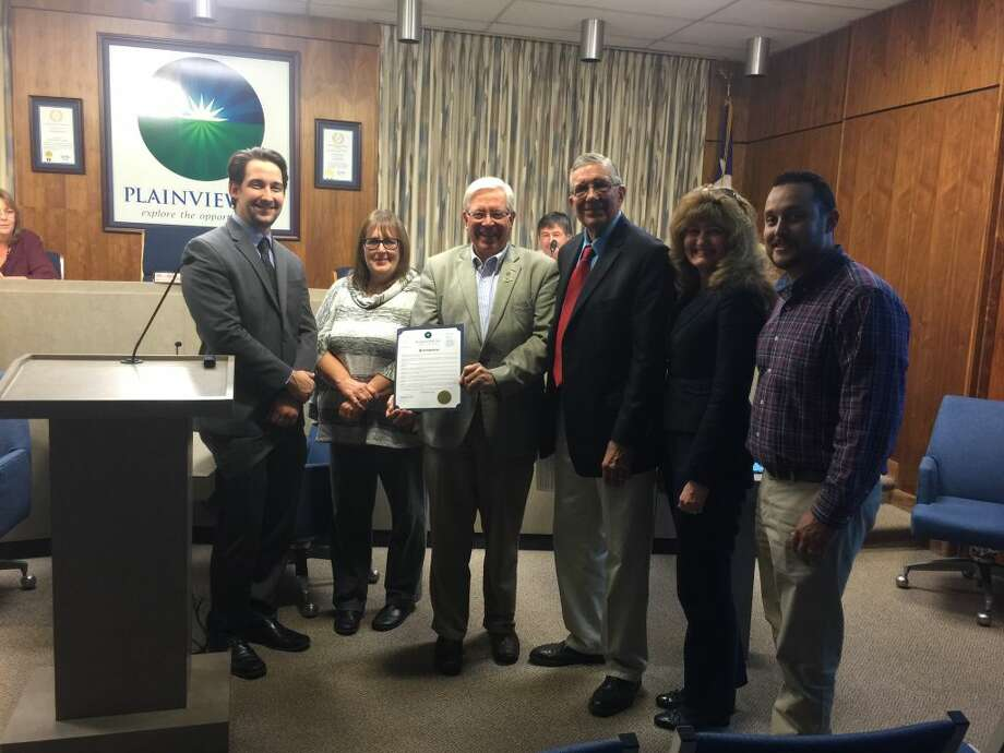 Plainview mayor Wendell Dunlap made a proclamation recognizing World Polio Day during Tuesday's city council meeting. Joining Dunlap were Rotary Club members Andrew Freeman, Susan Blackerby, Dr. Charles Starnes, Dunlap, Leslie Spear Schmidt and Isauro Gutierrez. Photo:  Homer Marquez/Plainview Herald