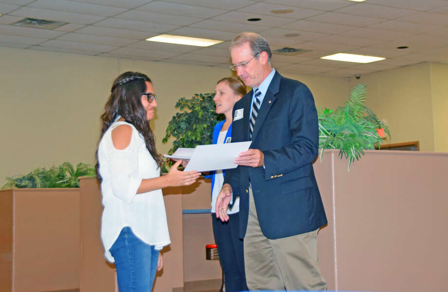PHS sophomore Glenda Abrego (left) accepts a certificate of completion of the EverFi financial literacy program from Willis McCutcheon, president of the Plainview branch of Happy State Bank. Assisting with the presentation of certificates is EverFi representative Briana Nistler.