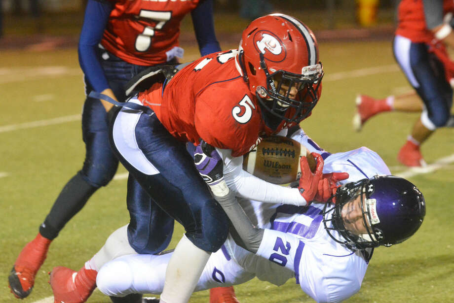 Plainview running back Warren Flye runs over a Canyon defender during a game earlier this season. The senior is off to a fast start this season with 497 yards rushing and 249 yards receiving in four games. Photo: Skip Leon/Plainview Herald