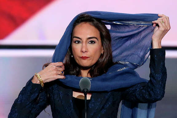 Harmeet Dhillon of San Francisco, vice chairwoman of the state party, delivers a Sikh prayer on stage.