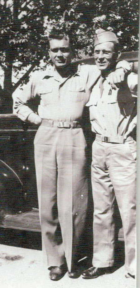 This World War II-era photograph shows business partners Leighton H. Maggard (left) and Hall Nall. Originally in the insurance business in Lockney, they operated the Chrysler-Plymouth-GMC Truck dealership in Plainview for many years.