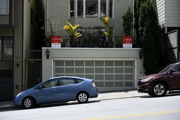 For sale signs outside a home for sale on Broadway St. on Tuesday, July 19, 2016 in San Francisco, California.
