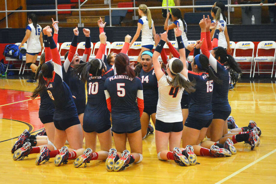 The Plainview volleyball team celebrates its victory over San Angelo Lake View Friday in the opening District 4-5A match for both teams. The Lady Bulldogs won in four games. Photo: Doug McDonough/Plainview Herald