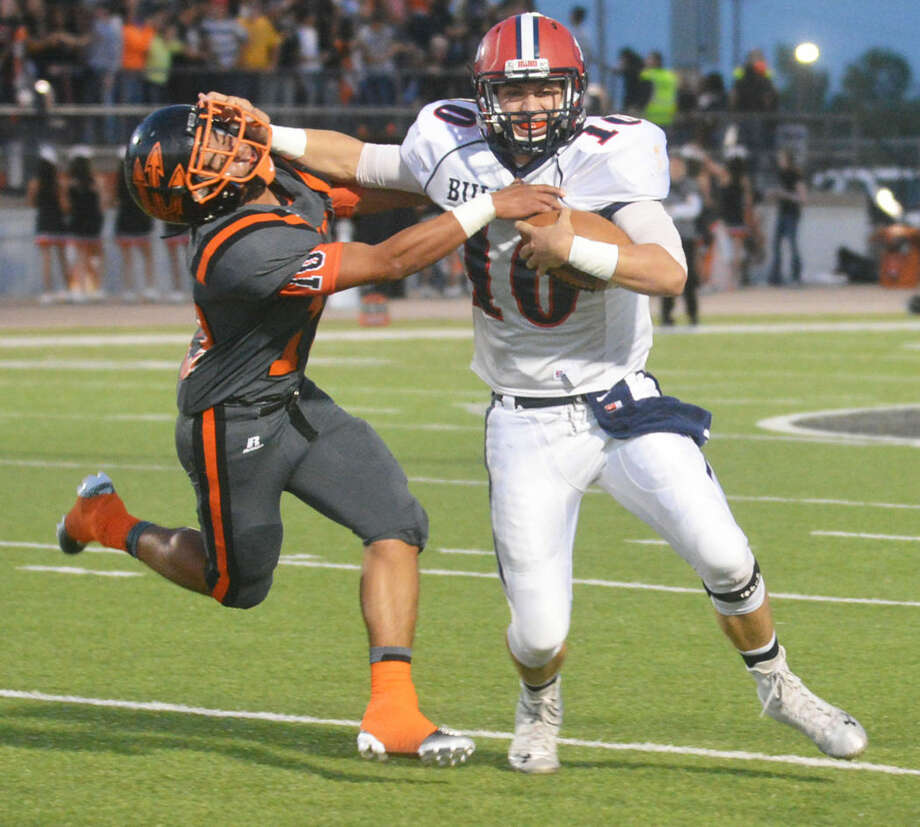Plainview quarterback Paxstyn Oldfield gives a stiff-arm to Dumas defender Andrew Concha during the first quarter of Friday night's football game. Oldfield passed for two touchdowns as the Bulldogs romped to a 41-14 victory, their second in a row. Photo: Skip Leon/Plainview Herald