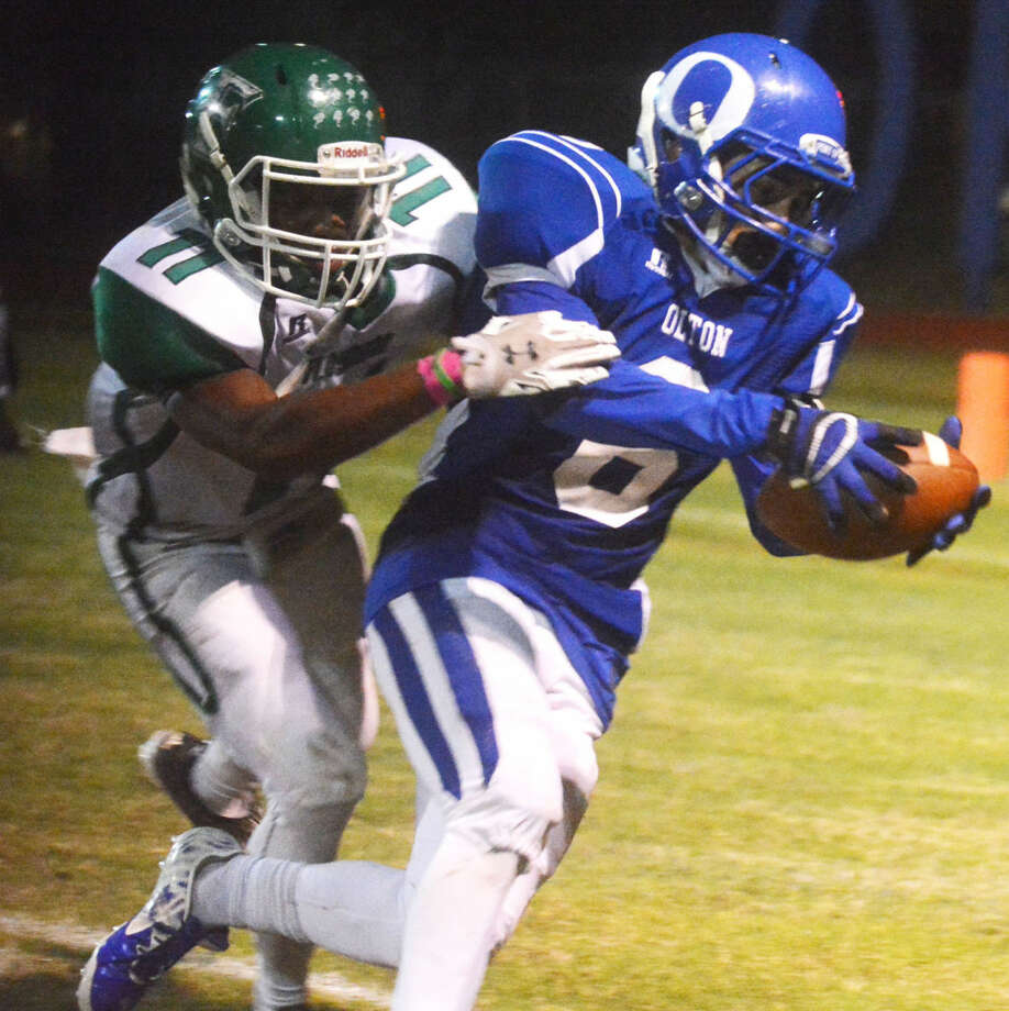 Olton's Bryan Valencia (6) tries to escape the grasp of Floydada's Kyi Baker (11) during a game earlier this season. Valencia has been moved from receiver to running back and has helped spark the Mustangs the past two weeks. Olton and Hale Center play Friday night with the winner qualifying for the playoffs. Photo: Skip Leon/Plainview Herald