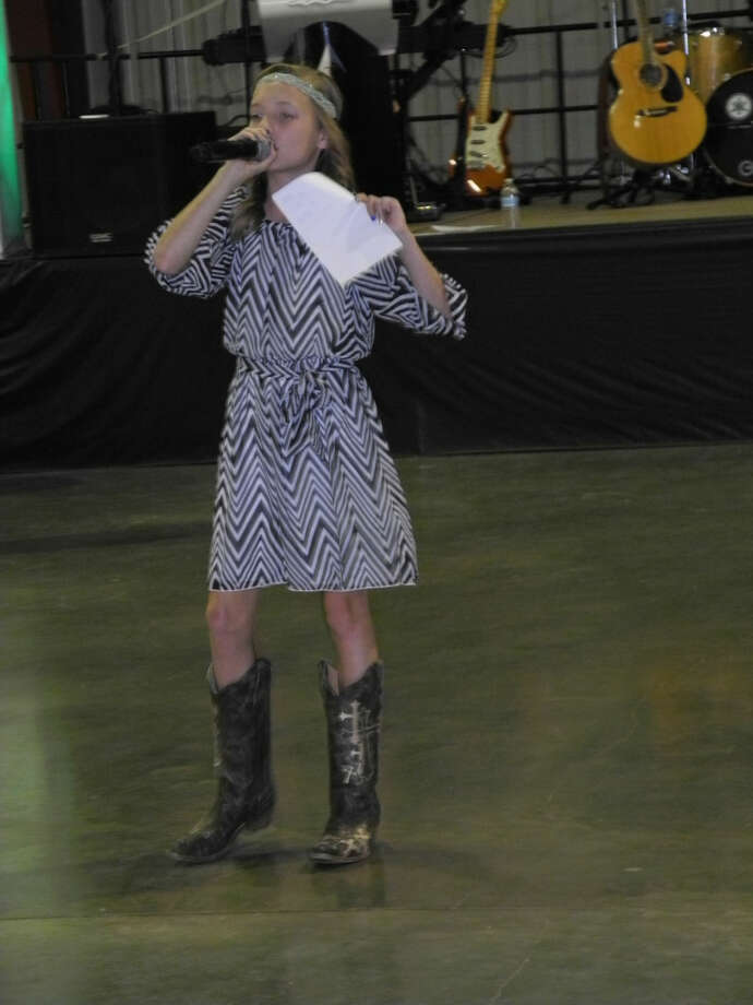At age 13, junior auctioneer Brooklyn Golden is proficient at her craft, coaxing bidders to raise the prices on donated items for a charity event Saturday. Proceeds from fundraising dinner and dance benefited the W.J. Mangold Memorial Hospital Equipment Fund. Photo: Gail M. Williams | Plainview Herald
