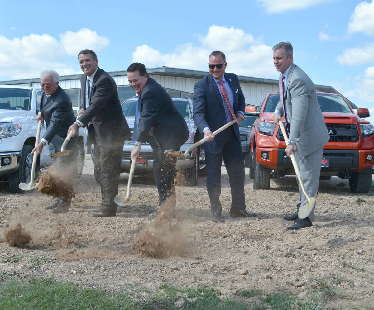 Doug McDonough/Plainview HeraldTaking part Monday in the formal groundbreaking for the new Reagor-Dykes Toyota dealership at 1220 S. I-27 in Plainview are Tom Bittenbender (left), senior vice president of sales for Gulf States Toyota; Rick Dykes, dealership co-owner; Eddie Ashburn, Plainview general manager; Bart Reagor, co-owner; and Marty Collins, Gulf States Toyota president. The new building will open during summer 2015.