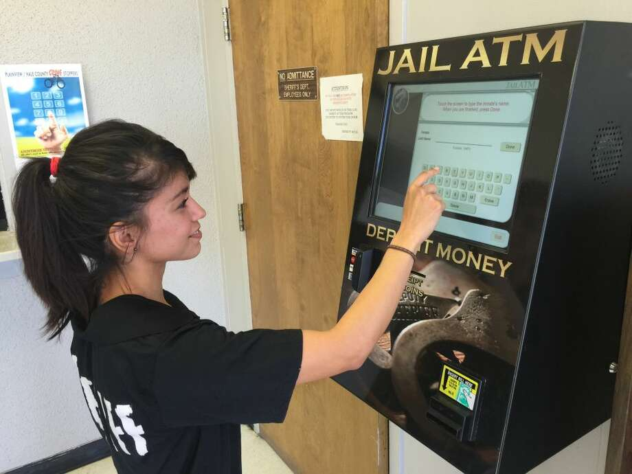 Hale County Sheriff's Deputy Benita Rodriguez demonstrates the jail's new commissary ATM machine. Photo: Homer Marquez/Plainview Herald