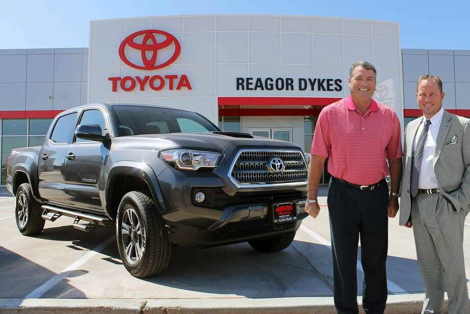 Rick Dykes and Bart Reagor display a Tacoma pickup outside the all new Reagor-Dykes Toyota, at 1220 S. I-27. The new Toyota dealership opens Monday.
