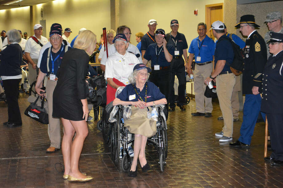 Doug McDonough/Plainview HeraldWilma Coon, a 90-year-old World War II veteran who served as a nurse in the Navy, was the first of almost 100 veterans to board a Southwest Airlines flight at Lubbock on Wednesday in this year's South Plains Honor Flight. In all more than 150 from the Lubbock area, including guardians, staff and veterans from World War II, Korea and Vietnam are making the three-day trip to Washington, D.C. to visit the National WWII Memorial. The flight departed about 6:45 a.m. Wednesday with the delegation due to return at 9:45 p.m. Friday.