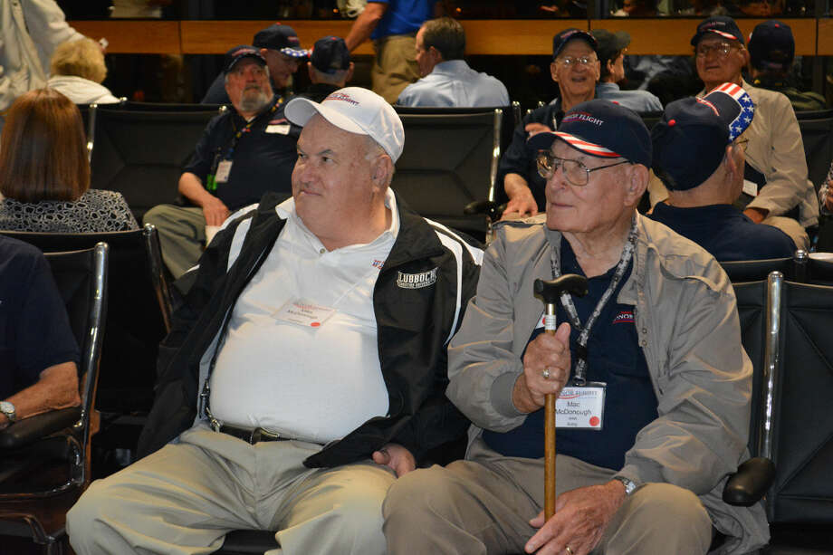 John McDonough (right), a World War II Army veteran, is another Plainview resident participating in the 2014 South Plains Honor Flight that departed from Lubbock on Wednesday morning. Accompanying him is son Mike McDonough (left), also from Plainview.